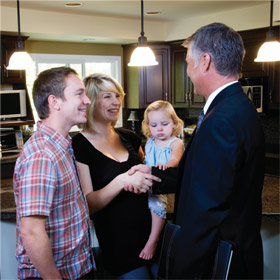 happy family after selling there house in kelowna with greg clarke realtor